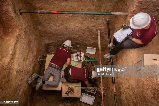 Anthtopologist volunteers work on the mass grave number 128 at the cementery of Paterna on August 29 2018 in Paterna Spain According to local...