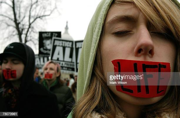 Anti abortion supporters wear tape over their mouths that read 'Life' during a rally in front of US Supreme Court building January 22 2007 in...