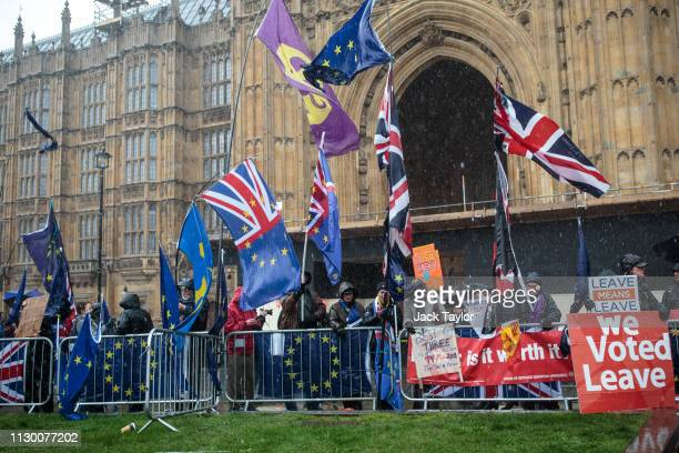 Anti and proBrexit protesters demonstrate outside the Houses of Parliament on March 12 2019 in London England MPs who rejected British Prime Minister...