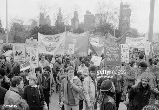 Anti apartheid in South Africa protesters demonstrate during the Wales vs Welsh Presidents match on 7th April 1984 at the Cardiff Arms Park in...