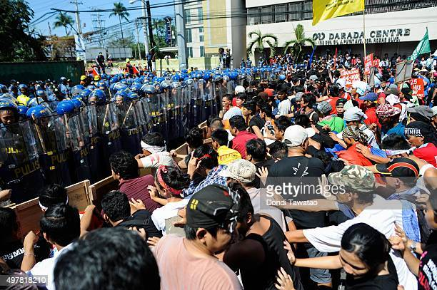 Anti APEC protestors face off with riot police near the venue hosting the Asia Pacific Economic Cooperation summit of economic leaders meeting on...