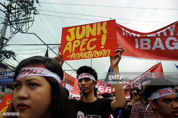 Anti APEC protestors march near the venue hosting the AsiaPacific Economic Cooperation Summit of Leaders on November 18 2015 in Manila Philippines...