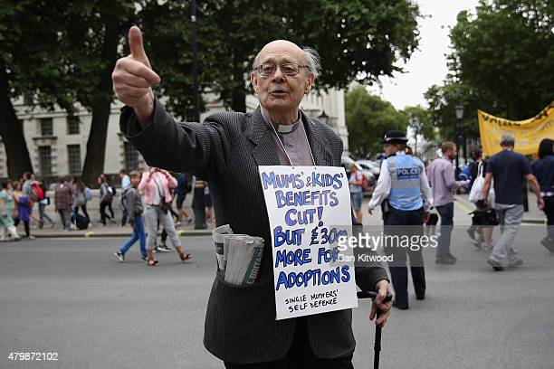 Anti austerity protesters gather outside Downing Street as the Chancellor of the Exchequer George Osborne left 11 Downing Street on July 8 2015 in...