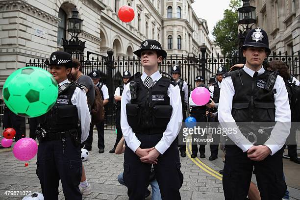 Anti austerity protesters throw balls towards Downing Street after the Chancellor of the Exchequer George Osborne left 11 Downing Street on July 8...