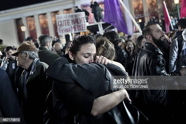 Anti austerity Syriza party supporters celebrate as leader Alexis Tsipras speaks folllowing victory in the election in Athens on January 25 2015 The...