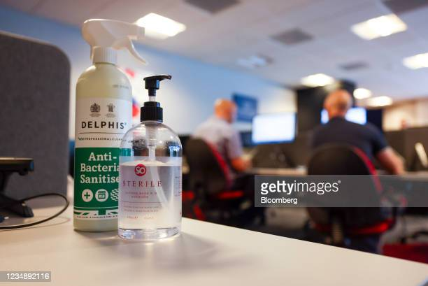 Anti bacterial spray and hand sanitizer on a desk in the offices of a branch of Metro Bank Plc in London, U.K., on Thursday, Aug. 26, 2021. Some two...