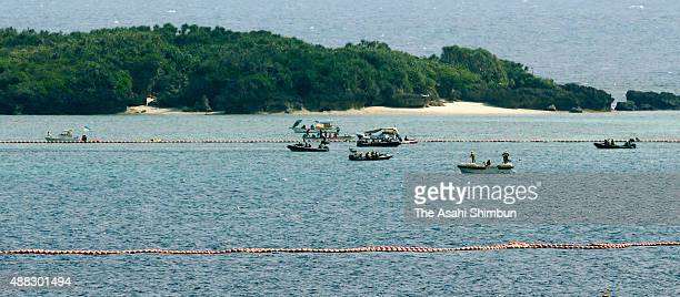 Anti base relocation protesters demonstrate on the sea near the central governmet's land reclaiming work site on September 14 2015 in Nago Okinawa...