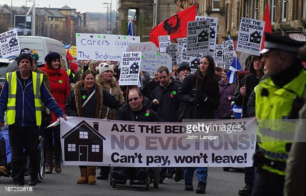 Anti bedroom tax protesters carrying banner on the march to George Square, Glasgow
