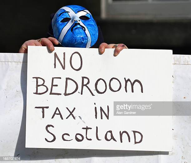 Anti Bedroom Tax protestor demonstrating against Ian Duncan Smith's visit to Edinburgh, outside George Hotel, Edinburgh.