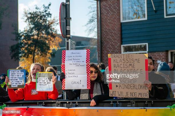 Anti Black Pete demonstrators in first line during the national entrance of Sinterklaas in Zaandstad Netherlands Like each year the first Saturday...