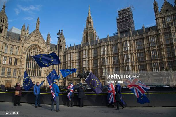 Anti Brexit and pro Europe demonstrators protest waving European Union and Union Jack flags in Westminster on 6th February 2018 in London England...