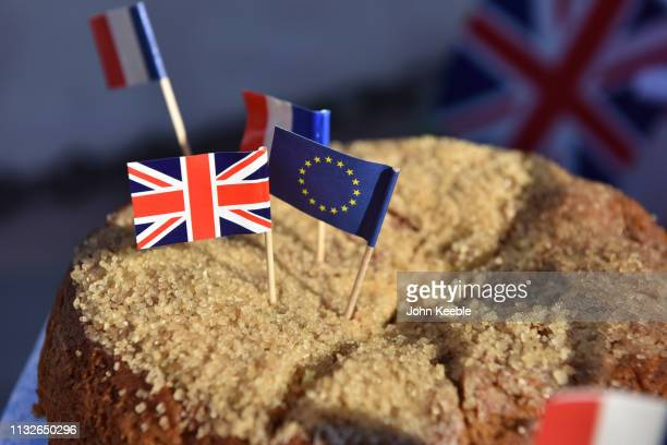 Anti Brexit Campaigners serve pies and cakes with Union Jack and European flags as they demonstrate outside the Houses of Parliament on February 27...