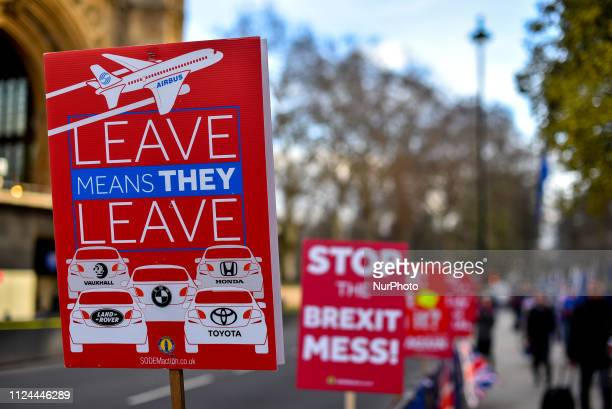 Anti Brexit demonstrators gather outside the Houses of Parliament waving EU and Union Flags and placards to protest against Brexit London on February...