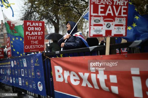 Anti Brexit demonstrators protest in the rain ahead of the meaningful vote in Parliament on March 12 2019 in London England MPs who rejected Theresa...