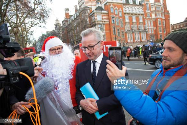 Anti Brexit pro Europe demonstrator dressed up as Santa Claus confronts Michael Gove MP shouting at him that he doesn't understand the needs and...