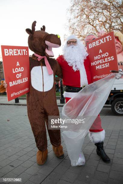 Anti Brexit pro Europe demonstrator dressed up as Santa Claus in Westminster opposite Parliament on 12th December 2018 in London England United...