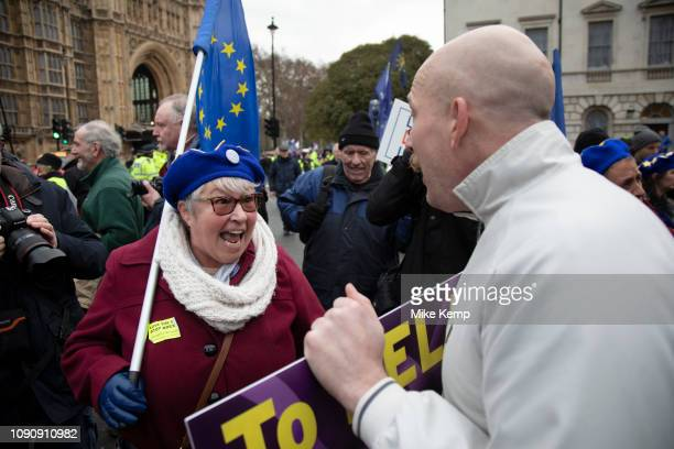 Anti Brexit pro Europe demonstrators argue in debate with a pro Brexit Leave means leave protester in Westminster opposite Parliament on the day MPs...