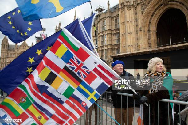 Anti Brexit pro remain demonstrators protest waving European Union and Union Jack flags in Westminster opposite Parliament on the day that...