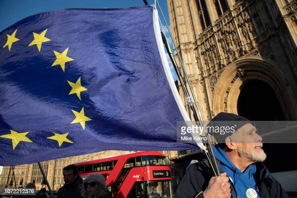 Anti Brexit pro remain demonstrators protest waving European Union flags in Westminster opposite Parliament on the day that Conservative Party MPs...