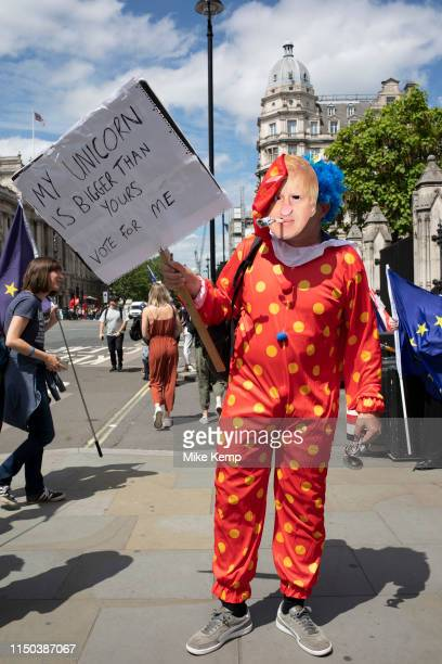 Anti Brexit protester in Westminster dressed up as a clown Boris Johnson tells passers by his policies which are all about 'Me' as inside Parliament...