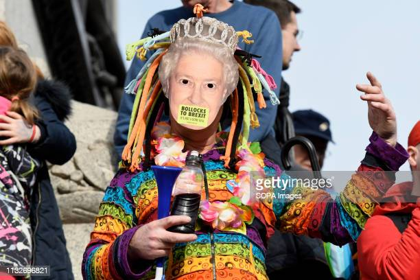 Anti brexit protester seen wearing a mask with the Queen Elizabethh portrait in Trafalgar Square during the demonstration Over a million people...