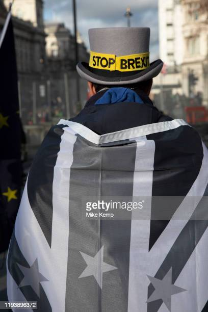 Anti Brexit protester Steve Bray wearing his new black and grey UK and European Union flags which he says are due to feeling 'sombre' at Westminster...
