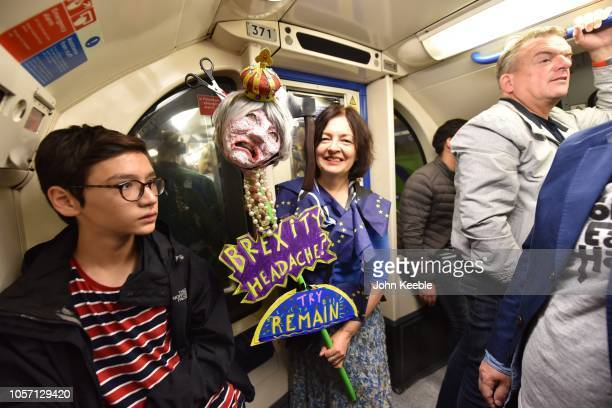 Anti Brexit protester with an effigy of Theressa May makes her way to the people's vote march on a tube train on October 20 2018 in London England...