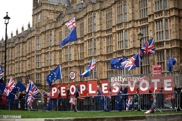 Anti Brexit supporters demand a Peoples Vote outside the Houses of Parliament Westminster on December 10 2018 in London England The Prime Minister is...