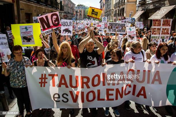 Anti bullfights protesters denouncing violence of bullfighting during a demonstration demanding the abolition of bullfighting