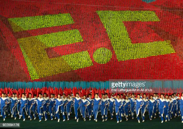 Anti capitalism human fresco made by children pixels holding up colored boards during Arirang mass games in may day stadium Pyongan Province...