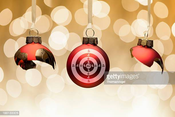 Anti Christmas concept - bauble target aiming broken