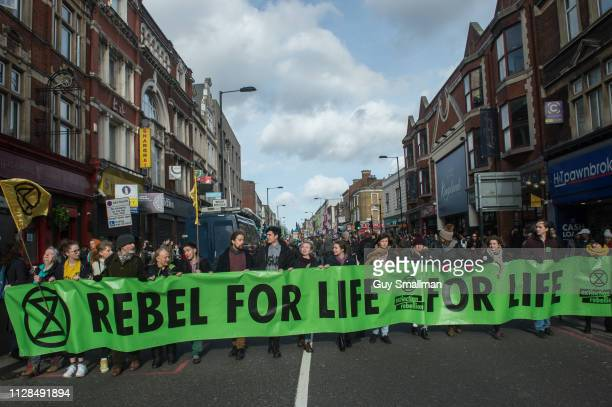 Anti climate change direct action group 'Extinction Rebellion' block the A10 in Dalston Hackney as part of a series of theatrical and disruptive...