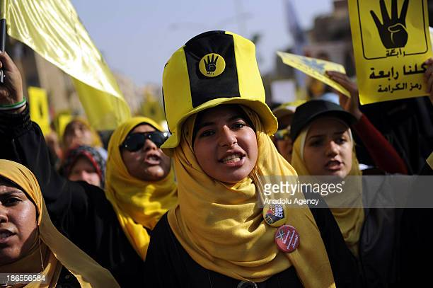 Anti coup demonstrators show 'Rabia sign' during a demonstration called ''of the people's will'' on November 1 2013 in the 6th of October city of...