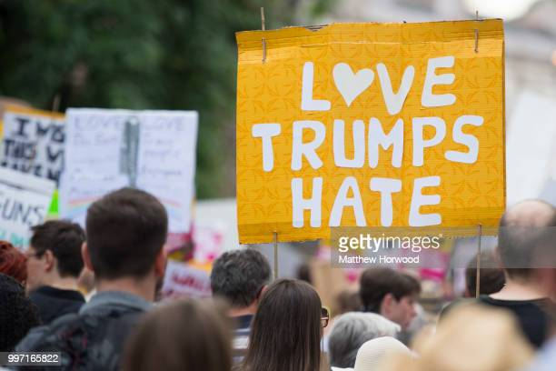 Anti Donald Trump signs are seen as protesters gather outside Cardiff Library on the Hayes in Cardiff to protest against a visit by US President...