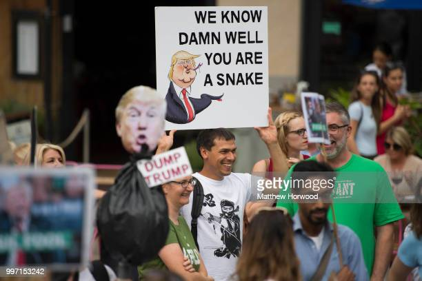 Anti Donald Trump signs are seen as protestors gather outside Cardiff Library on the Hayes in Cardiff to protest against a visit by the President of...