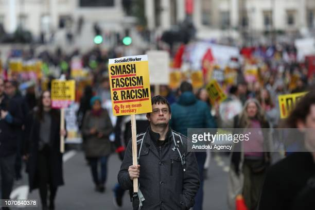 Anti fascist protesters march in central London during a simultaneous UKIP led Brexit protest in which the far right activist Tommy Robinson took...