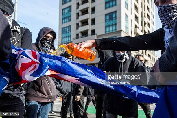 Anti fascists pour flammable liquid on the Australian Flag before burning it during a protest organized by the antiIslam True Blue Crew supported by...