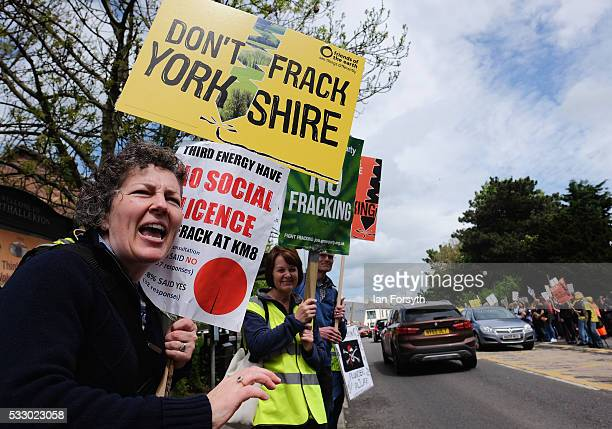 Anti fracking protestors rally support from passing motorists outside the County Hall building in Northallerton as the County council's Planning and...