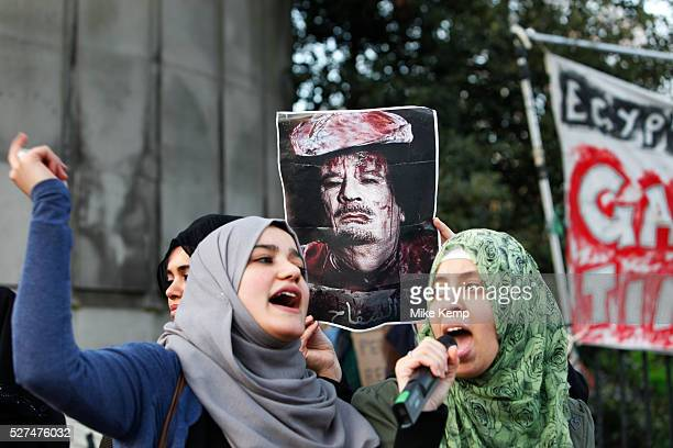 Anti Gaddafi protesters in support of a free Libya demonstrate outside the Libyan Embassy in London While chanting slogans they hold up pictures of a...
