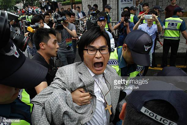 Anti gay activists scuffle with police during the Korea Queer Culture Festival 2016 in front of City hall on June 11 2016 in Seoul South Korea