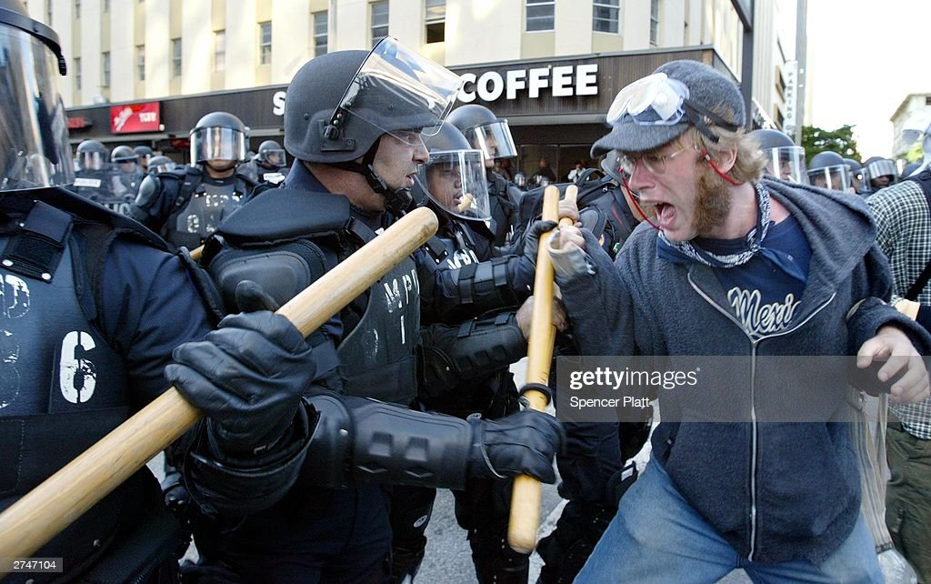 Anti globalization protesters clash with police in riot gear November 20, 2003 on the fourth day of the summit to create a Free Trade Area of the Americas (FTAA) being held in Miami, Florida. Hundreds of protesters, including groups of anarchists, clashed with the police throughout the morning as the protesters unsuccessfully tried to make their way to the summit building. Much of the city of Miami is in a police lockdown, with thousands of businesses closed and a steel barricade circling the summit area.