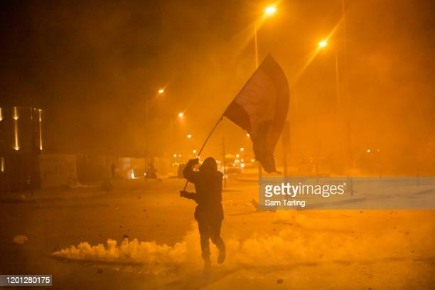 Anti government protesters and riot police clash during a second day of violence, on January 22, 2020 in Beirut, Lebanon. Weeks of bickering between...