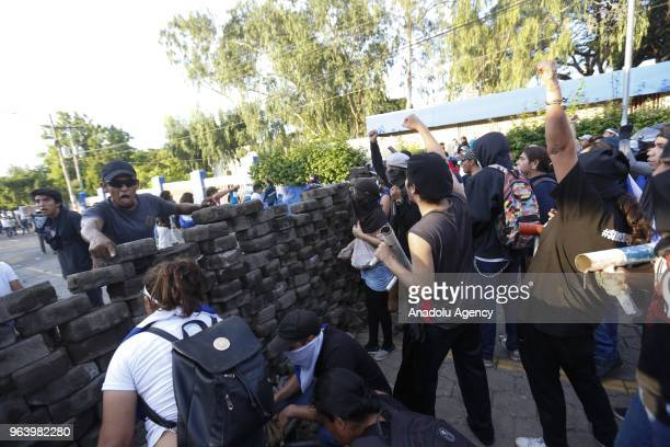 Anti government protesters built a barricade as they take part in the march of mothers' day called in memory of the dead and disappeared during the...