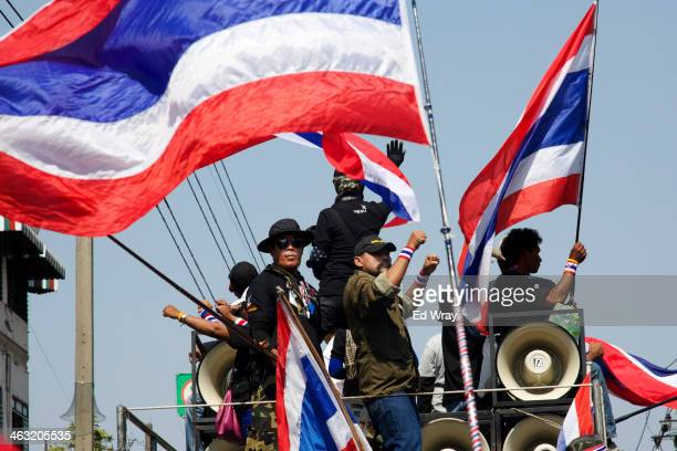 Anti government protesters cheer atop a truk during a march shortly before an explosive device went off nearby wounding more than 20 people on...