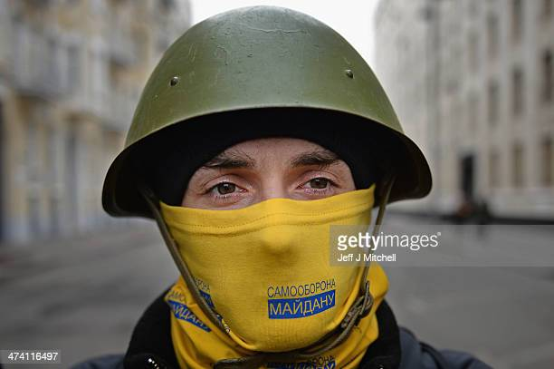 Anti government protestors guard the streets next to the Presidential offices on February 22 2014 in Kiev Ukraine The offices of Ukrainian President...