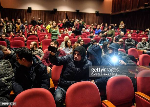 Anti LGBT rights protesters stop a movie screening at the Romanian Peasant's Museum in Bucharest Romania on February 8 2018 Thirty people...