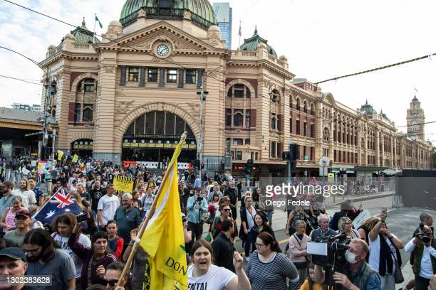 Anti lockdown protesters are seen leaving Flinders Street Station to start their march of protest, following the announce of the lockdown on February...
