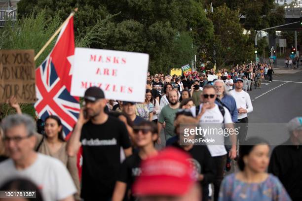 Anti lockdown protesters are seen marching towards Parliament House, following the announcement of the lockdown on February 12, 2021 in Melbourne,...