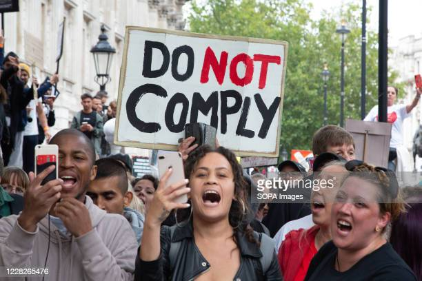 Anti mask protesters gather outside the Whitehall while shouting slogans during the demonstration. Protesters demonstrate against the wearing of face...