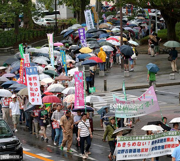 Anti national security legislation laws protesters march on during a rally on September 19 2016 in Nagoya Aichi Japan People express their continued...